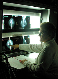 US Navy 030425-N-4150K-001 Imaging Specialist Barbaranne Foster, reviews a patient^rsquo,s x-ray.jpg